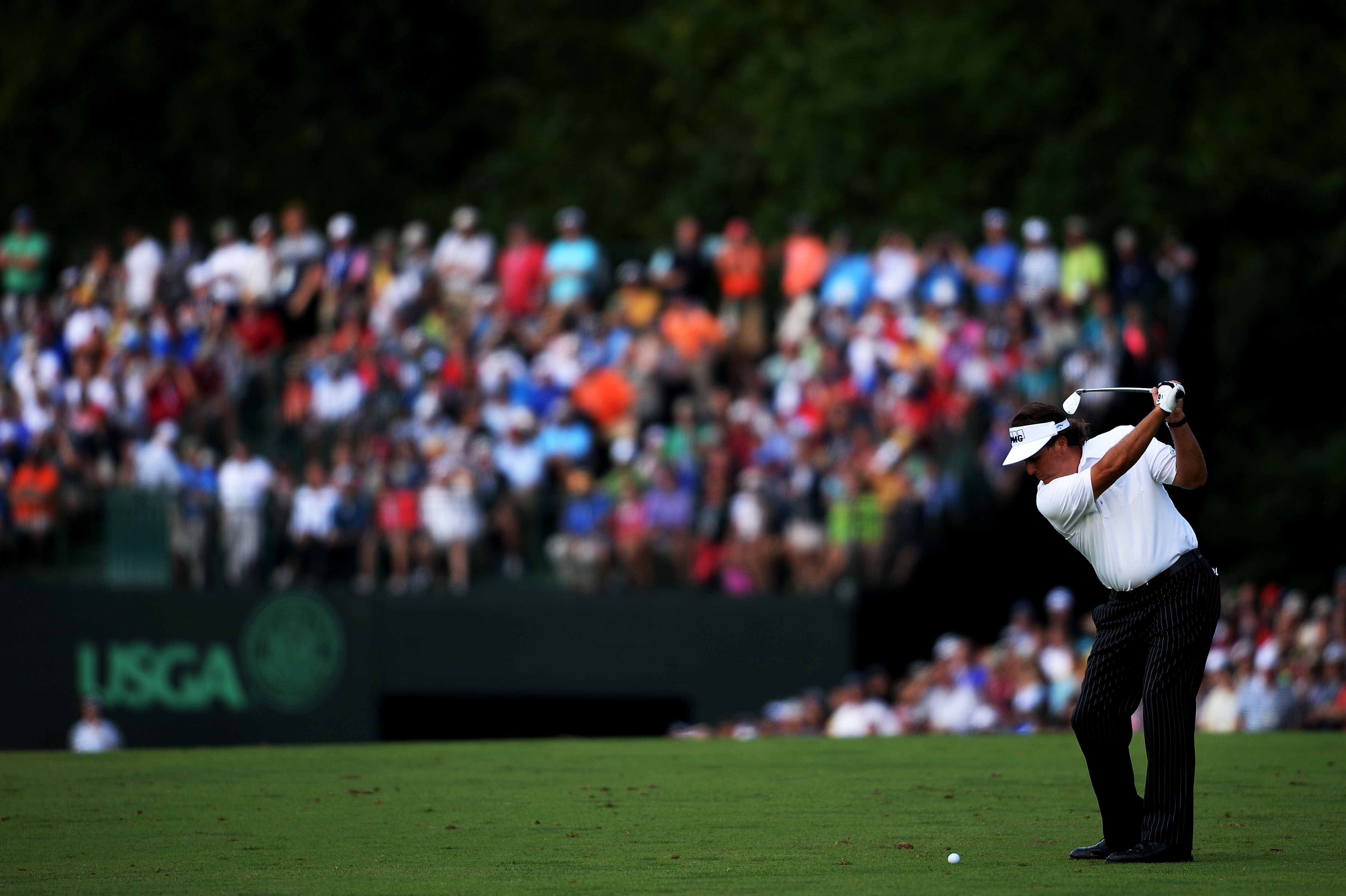 ARDMORE, PA - JUNE 14: Phil Mickelson of the United States hits an approach shot on the eighth hole during Round Two of the 113th U.S. Open at Merion Golf Club on June 14, 2013 in Ardmore, Pennsylvania. Ross Kinnaird/Getty Images Sport
