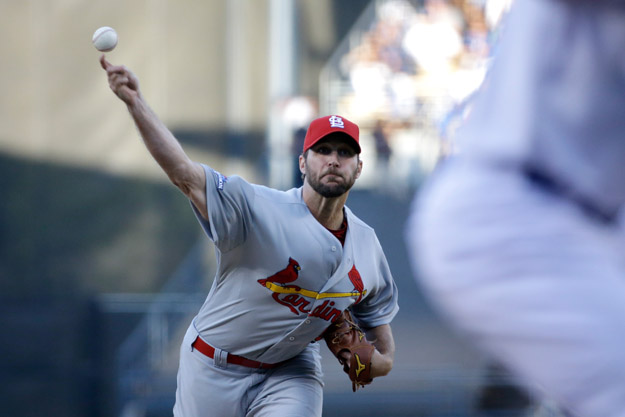LOS ANGELES, CA - OCTOBER 14:  Adam Wainwright #50 of the St. Louis Cardinals pitches in the first inning against the Los Angeles Dodgers in Game Three of the National League Championship Series at Dodger Stadium on October 14, 2013 in Los Angeles, California.