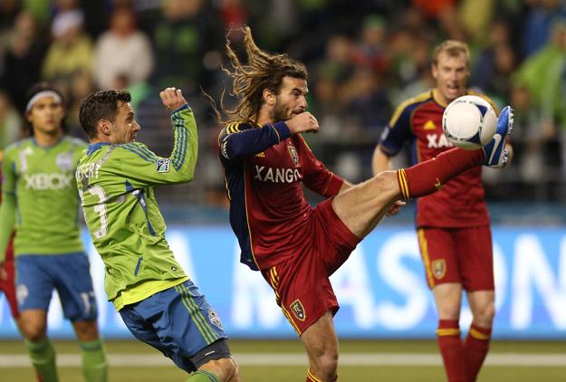 SEATTLE, WA - NOVEMBER 02:  Kyle Beckerman #5 of Real Salt Lake battles Christian Tiffert #13 of the Seattle Sounders FC at CenturyLink Field on November 2, 2012 in Seattle, Washington. The Sounders and Real Salt Lake played to a nil-nil tie.