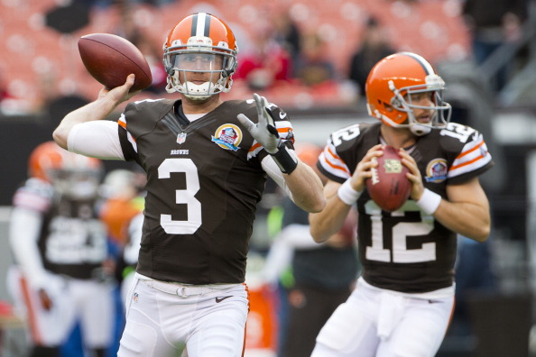 Brandon Weeden #3 and Colt McCoy #12 (Photo by Jason Miller/Getty Images)