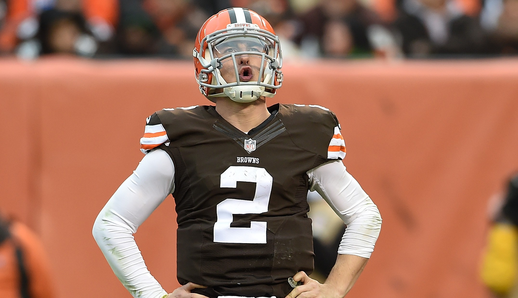 Johnny Manziel #2 of the Cleveland Browns reacts after being sacked during the third quarter against the Cincinnati Bengals at FirstEnergy Stadium on December 14, 2014 in Cleveland, Ohio.  (Photo by Jason Miller/Getty Images)