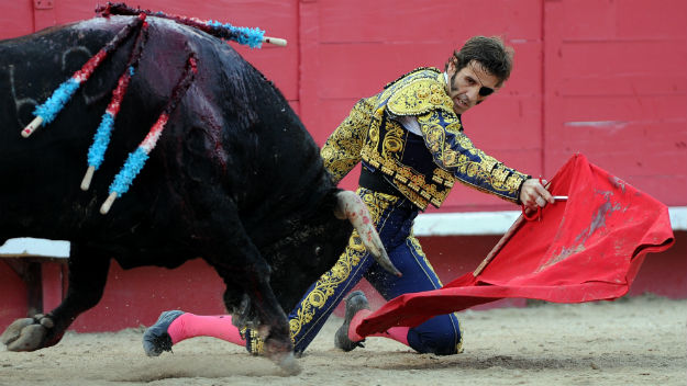 Spanish matador Juan Jose Padilla performs against a Domingo Hernandez bull during an Easter bullfight on April 6, 2012 in Arles, southern France. Spanish matador Juan Jose Padilla, blinded in one eye by a horrific goring less than six months ago, returned to the ring with a patch over his left eye and his face still partially paralysed. (Photo credit GERARD JULIEN/AFP/Getty Images)